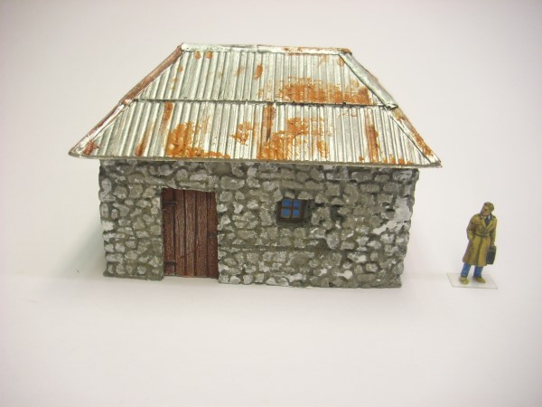 STONE BUILDING WITH SHEET METAL ROOF