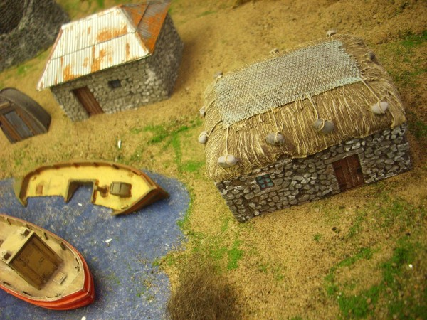 STONE CROFT WITH GRASS ROOF AND NET.