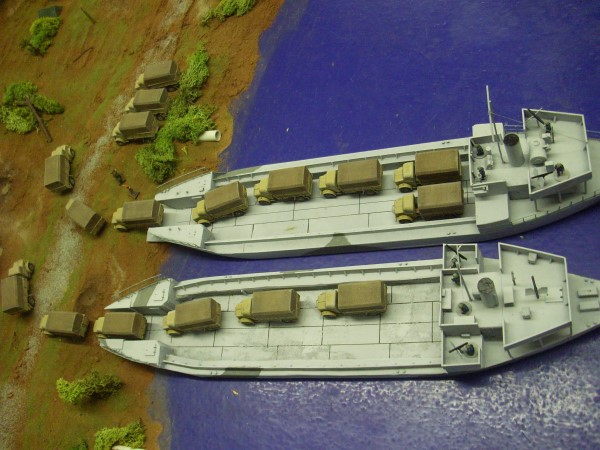 My cardboard LST's offload some 20mm Bedford OYD's